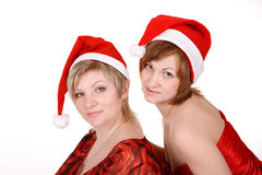 Twee vrouwen in rode kappen. Royalty-vrije Stock Afbeeldingen