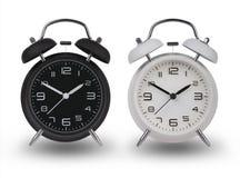 Twee wekkers met de handen bij 10 en 2 Royalty-vrije Stock Afbeeldingen