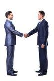 Twee zakenman het schudden handen stock afbeeldingen