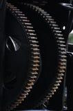 Twee zwarte tandwielen Stock Afbeelding