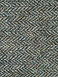 Tweed fabric texture. Closeup of tweed fabric showing zigzag pattern of threads Royalty Free Stock Images