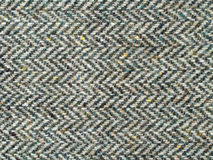 Tweed fabric texture. Closeup of tweed fabric showing zigzag pattern of threads Stock Images