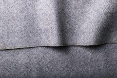 Tweed fabric, wool gray herringbone textile background. Stock Photos