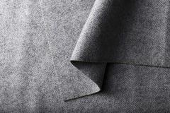 Tweed fabric, wool gray herringbone textile background. Stock Image