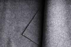 Tweed fabric, wool gray herringbone textile background. Stock Photography
