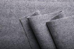 Tweed fabric, wool gray herringbone textile background. Stock Images