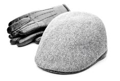 Mens accessories studio quality white background. Tweed grey cap black leather gloves white background Stock Image