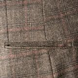 Tweed jacket fragment. Tweed striped jacket cloth material fragment with the pocket as a background texture composition Royalty Free Stock Photography