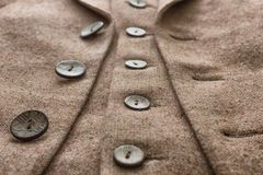Tweed jacket with its details of buttons. And accessories Royalty Free Stock Photo