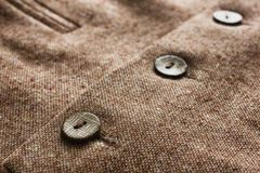 Tweed jacket with its details of buttons. And accessories Stock Photo