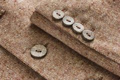 Tweed jacket with its details of buttons Stock Photography