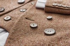 Tweed jacket with its details of buttons. And accessories Royalty Free Stock Photos