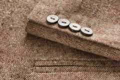 Tweed jacket with its details of buttons. And accessories Royalty Free Stock Image