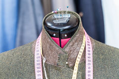 Tweed jacket on mannequin and ready suits Stock Photography