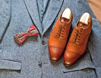 Tweed and leather. Tweed jacket bow-tie and oxford shoes Stock Image