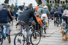 Tweed ride 2017. A lot of unknown people in ancient costumes with bicycles traveling on city streets. Stock Image