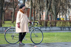 Tweed ride 2017. Unknown woman in ancient dress standing at the bike. Stock Photo