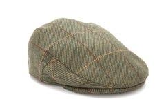 Tweed vert chassant le chapeau plat photographie stock libre de droits