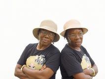 Tweelingen in zwarte Royalty-vrije Stock Afbeeldingen