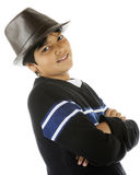 Tween with Attitude in Fedora. A handsome, biracial standing with a friendly attitude while wearing a brown fedora hat. On a white background stock photography