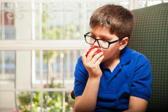 Tween biting an apple Stock Images