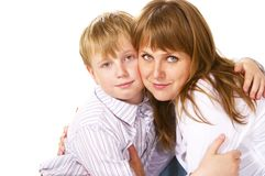 Tween boy hugging her mother Royalty Free Stock Image
