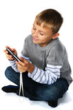 Tween boy with psp Stock Photo