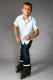 Tween boy rollerblading Stock Photo