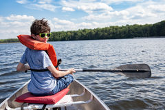 Tween boy in rowboat Stock Photos