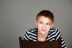 Tween boy smiling. Cute preteen blond boy smiling and looking to side and smiling Stock Images
