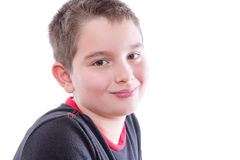 Tween Boy in Smiling Over Shoulder at Camera. Head and Shoulders Close Up Portrait of Young Tween Boy Wearing Black and Red T-Shirt and Smiling Over Shoulder at Stock Photos