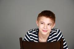 Tween chłopiec ono uśmiecha się obrazy stock