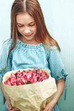 Tween girl holding bunch of roses Royalty Free Stock Photos