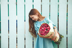 Tween girl holding bunch of roses Royalty Free Stock Photo