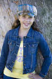 Tween Girl leaning on Tree Stock Image