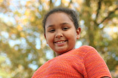 Tween girl posing outdoors. Litte girl posing outdoors with a big smile Stock Images