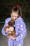 Tween girl in pyjamas with new puppy Royalty Free Stock Photo