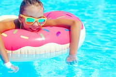 Tween girl in resort pool Stock Image