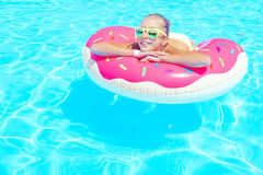 Tween girl in resort pool Royalty Free Stock Photo