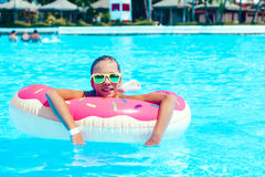 Tween girl in resort pool Royalty Free Stock Photos