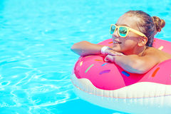 Tween girl in resort pool Stock Photos