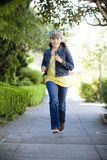 Tween Girl Running on sidewalk Royalty Free Stock Photos