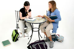 Tween Girls Doing Homework After School Stock Photo