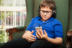 Tween listening to some music Royalty Free Stock Photos