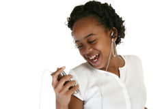 Tween Music. Beautiful tween girl with digital music player Stock Images
