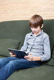 Tween with new tablet computer Stock Images
