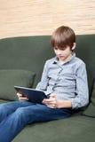 Tween with new tablet computer Stock Images