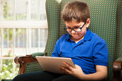 Tween playing games on a tablet Royalty Free Stock Image