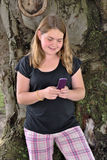 Tween Using Phone Royalty Free Stock Photography