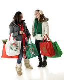 Tweens Meet Christmas Shopping. Two preteens meet and talk while Christmas shopping.  On a white background Stock Images